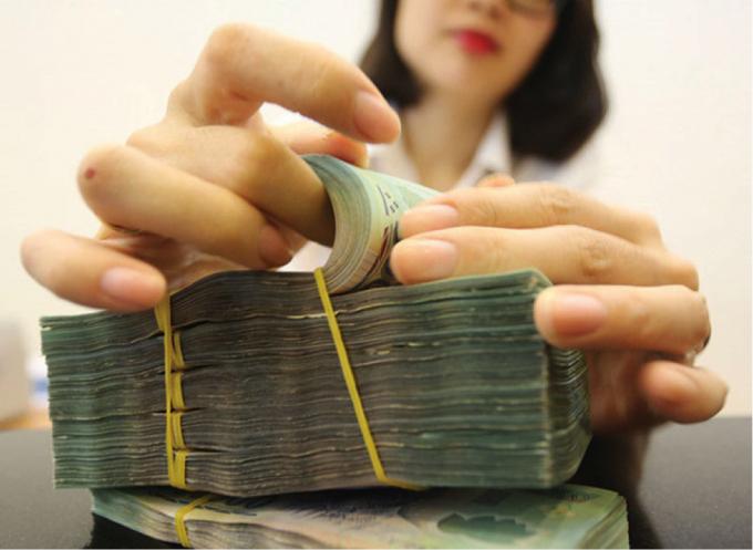 Tín dụng ngân hàng tăng 5%, tiền vẫn chảy đều vào ngân hàng