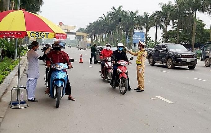 Bảo đảm trật tự, an toàn giao thông, công tác vận tải gắn với công tác phòng, chống dịch Covid-19