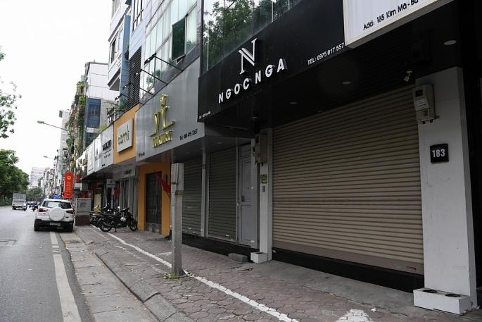 Dịch Covid-19 khiến hàng ngàn hộ kinh doanh tại Hà Nội phải dừng hoạt động.