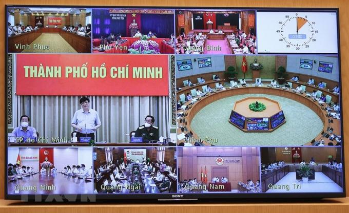 Cuộc họp trực tuyến từ điểm cầu Chính phủ đến các tỉnh, thành phố. Ảnh: TTXVN